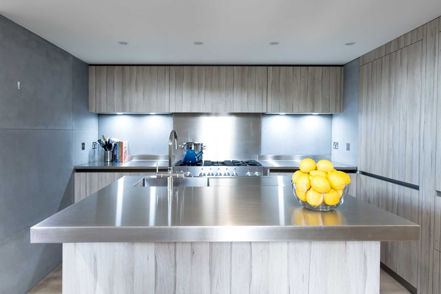 0244 modern kitchen with concrete tiles steel worktops and grey wood cabinets in St Johns Wood