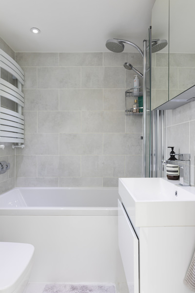 0605 small bathroom with shower and grey tiles in west london