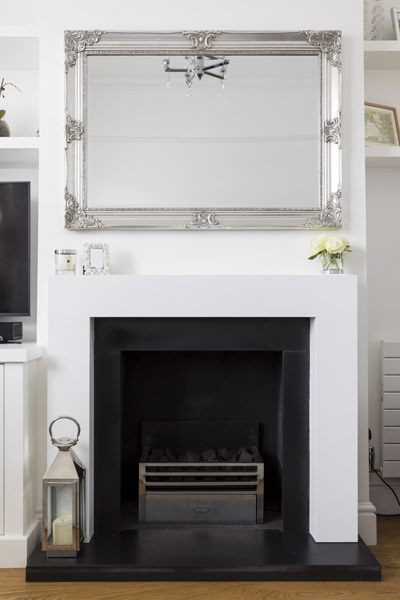 0605 white fireplace surround and silver mirror in living room