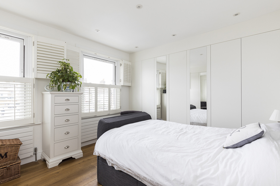 0605 master bedroom bed with builtin tv white shutters west london
