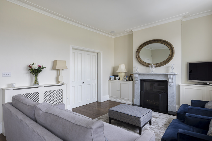 0631 double classic english reception room with sliding white door and fireplace niche cabinets