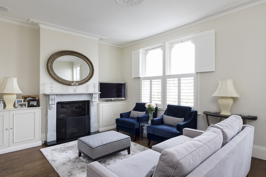 0631 elegant living room in london with grey sofa blue armchairs and shutters