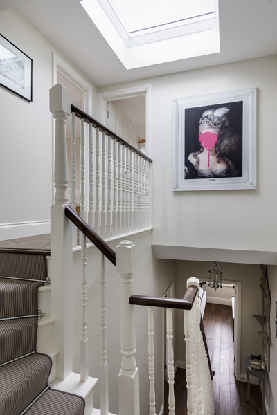 0631 staircase to loft conversion with roof light and art work in south london