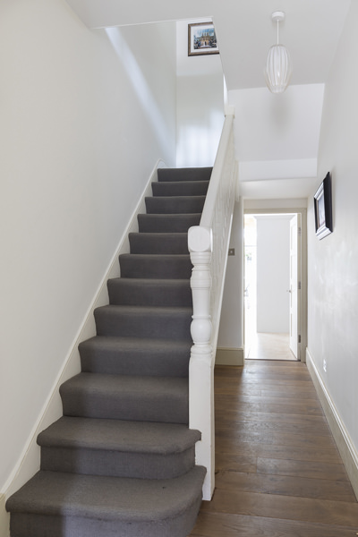 647 staircase with white wooden stairs and grey carpet in W4