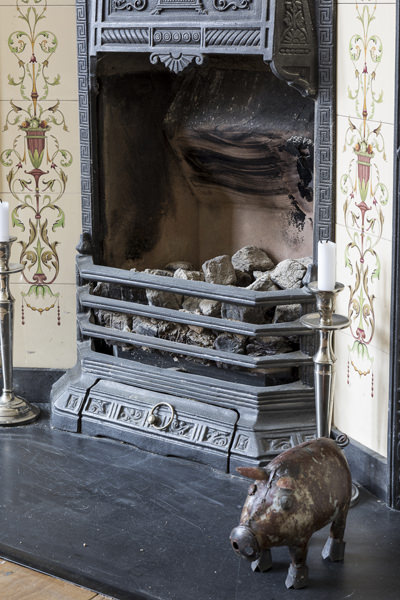 647 traditional iron and tiles fireplace with metal pig in london