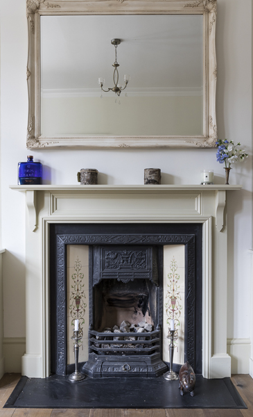 647-iron and tiles fireplace with a mirror above in living room in west london