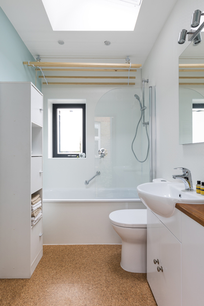0527 retro bathroom with cork floor and white units in Kentish town