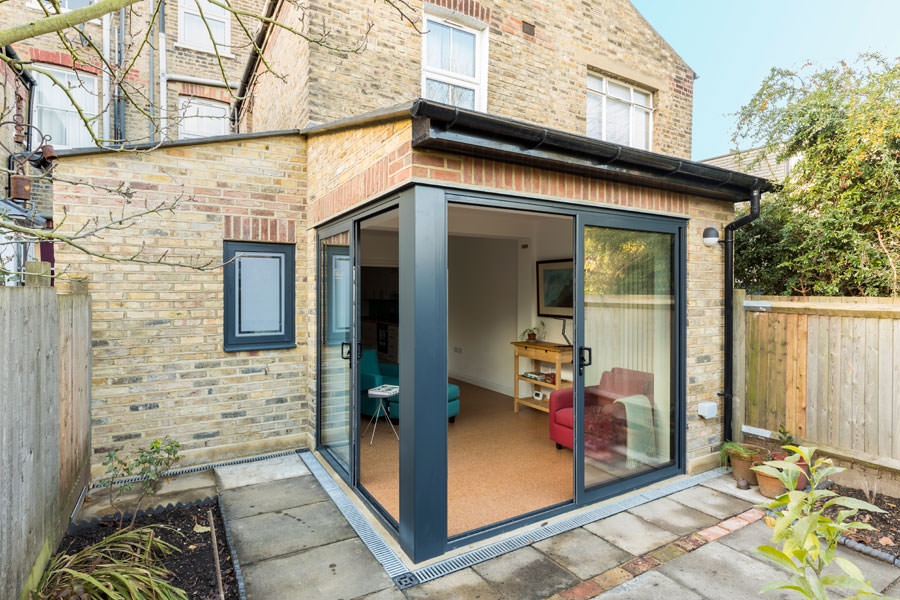 0527 rear house extension with sliding door on two sides in Dartmouth Park NW5