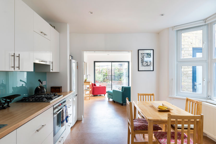 0527 kitchen diner with cork floor and white units in NW5 Kentish Town