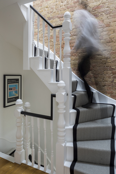 0557 exposed brick wall and white wooden staircase with grey carpet runner in south wimbledon