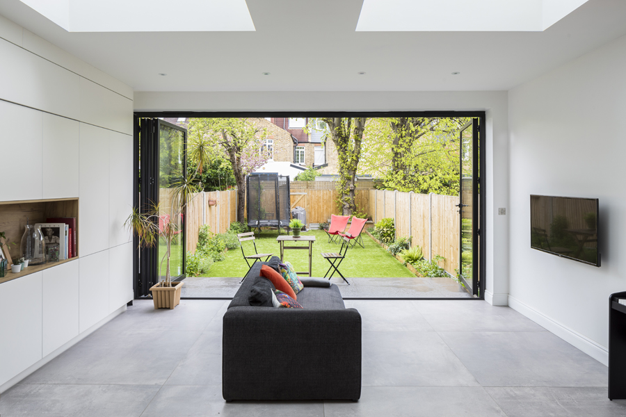 0557 modern living area in extension with grey tiles and bifold doors in london