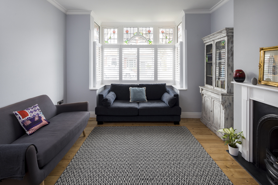 0557 cozy reception room with grey walls fireplace stained glass windows and shutters in south wimbledon