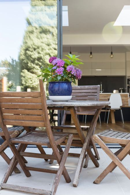 0558 Patio and wooden garden furniture in London house