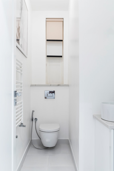 0587 white tiles guest toilet with blinds and towel heater