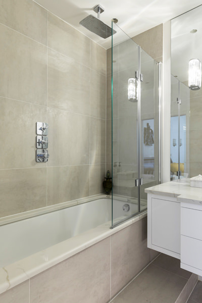 0587 master ensuite bathroom with beige tiles bath and shower