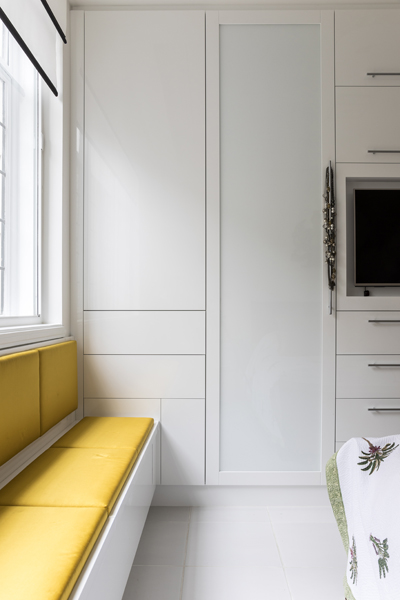 0587 high gloss white bedroom cabinet and yellow window seat in West London