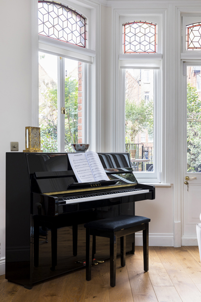 0736 piano by bay window in traditional london property