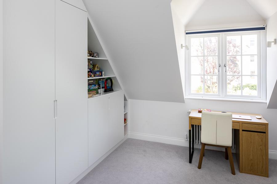 0776 build in white wardrobe storage in loft with children study desk
