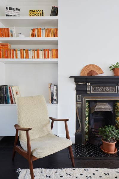 0848 traditional living room fireplace and midcentury armchair in white walls SW18