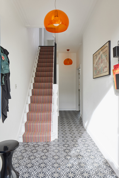 0848 light terraced house hallway with Marrakesh design blue tiles and orange lights in earsfield