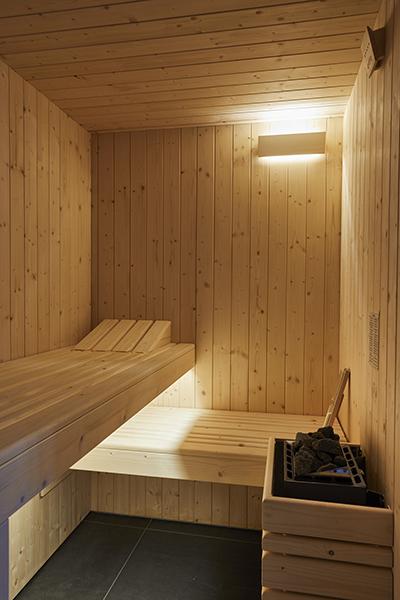 wooden sauna room design in apartment