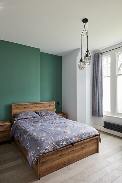 industrial bedroom green wall rustic