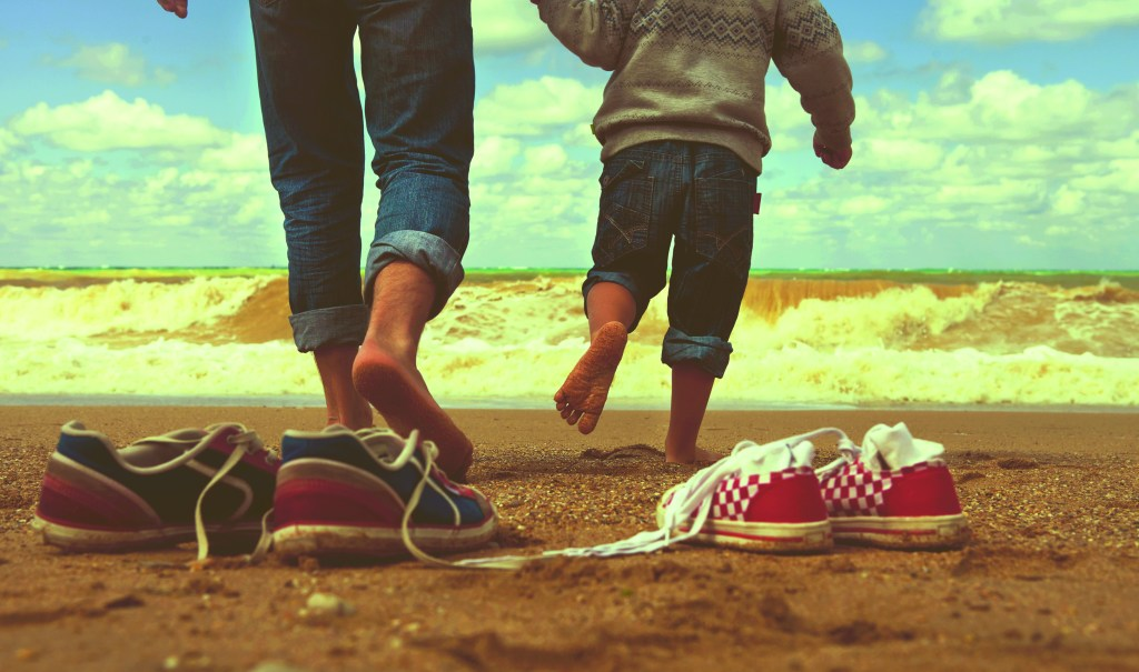 Close up image father and son legs walk at the seaside; Shutterstock ID 117189670; PO: redownload; Job: redownload; Client: redownload; Other: redownload