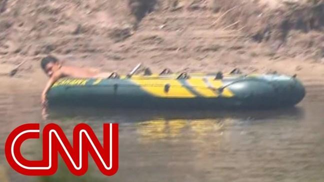 CNN films migrants crossing Rio Grande