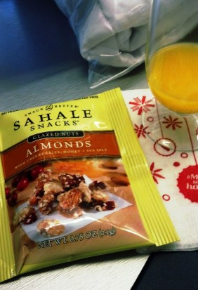 While I waited for someone to kick me back to coach, I snacked on orange juice and amazing almonds.