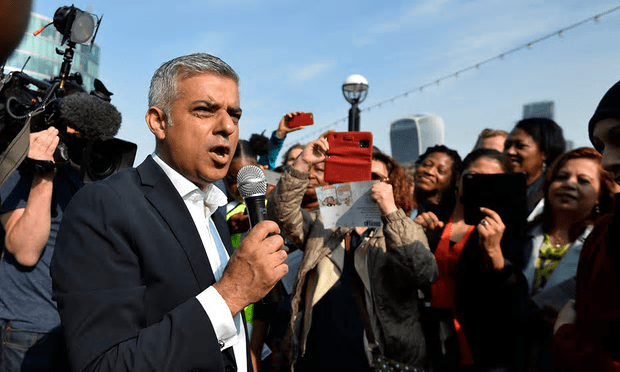 Sadiq Khan speaks to supporters as he arrives for his first day at work at City Hall in London on 9 May [Image: Hannah Mckay/Reuters].