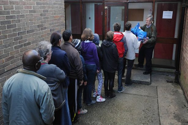 Food bank: Boxes of food are handed out to a queue [Image: North News & Pictures Ltd].