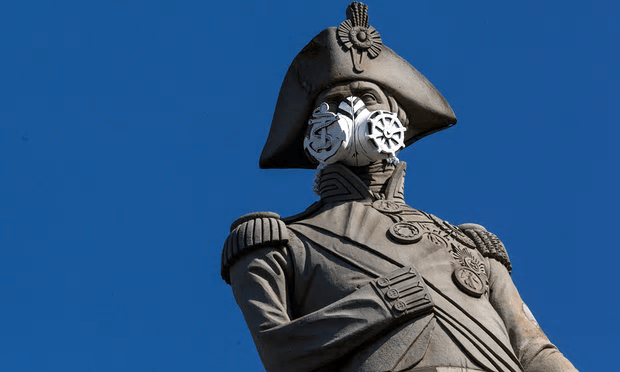 A face mask is placed on the statue of Nelson's Column by Greenpeace protesters in London. Londoners living in the city's most deprived areas were on average more exposed to poor air quality than those in more affluent areas [Image: Dan Kitwood/Getty Images].