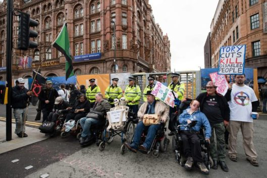 Disabled protestors block one of the entrances outside the annual Conservative party conference in Manchester, 2015 [Image: Leon Neal/Getty].