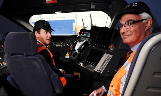 Not in the pilot's seat: George Osborne and Alistair Darling, who he appears to have taken for a ride.