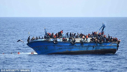 The new EU border force would focus much of its energy on the Mediterranean where images like this of overcrowded migrant boats capsizing have become all too common [Image: AFP/Getty Images].