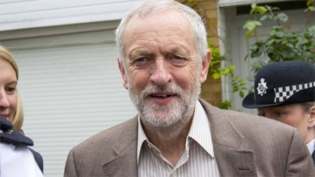 Mr Corbyn leaves his home smiling, despite the continuing Labour revolt [Image: PA].