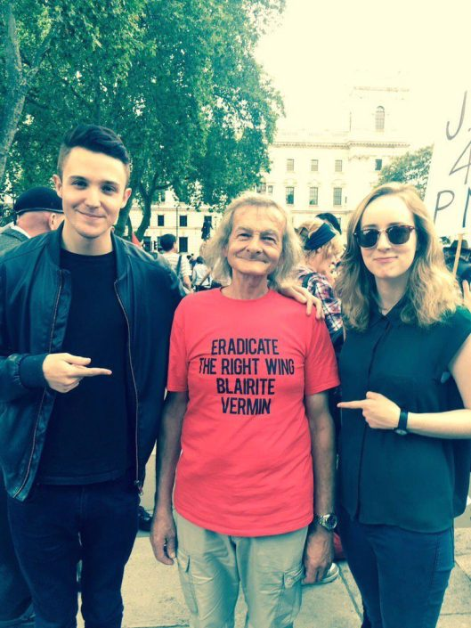 "The T-shirt smear against Jeremy Corbyn: On the left, Lewis Parker, ""creative strategist and media guru""; on the right, Anna Phillips of Blairite pressure group Progress - at the rally in support of Jeremy Corbyn on Monday, June 27. The media were in uproar about that T-shirt - at the wrong man."