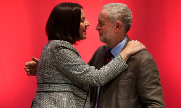 Kezia Dugdale and Jeremy Corbyn: Was she planning to stab him in the back at the Scottish Labour Conference in 2015, when this photo was taken? [Image: Press Association.]