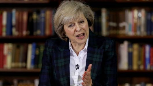 "Theresa May said the UK faced threats from ""conventional enemies"". Why, then, do we need a nuclear deterrent? [Image: AP.]"