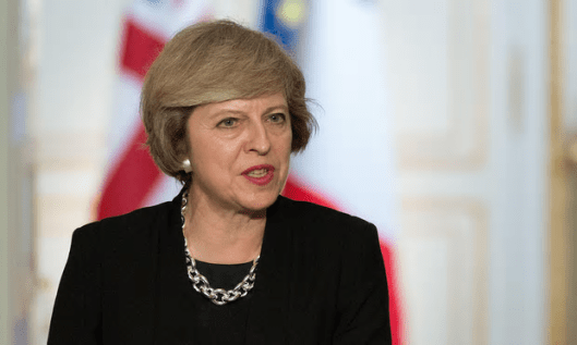 Theresa May promised to bolster the prospects of the poorest [Image: Villard/SIPA/Rex shutterstock].