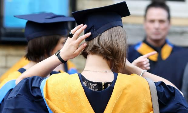 Graduates [Image: Chris Radburn/PA].
