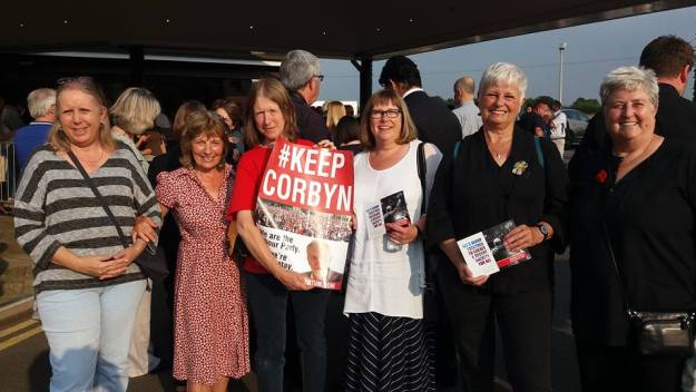 """This image by Elaine Jackson on the #thuginistas FB page sums up the gulf between the anti-Corbyn claims and the reality. The caption reads: """"Terrible #thuginistas at the Birmingham hustings last night! I hadn't been allocated a ticket but a friend transferred her ticket to me - such thuggery."""""""
