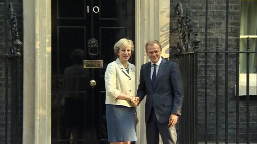 Awkward: When Theresa May met Donald Tusk, the handshake went on a long time - probably because she was trying to think of something worthwhile to say.