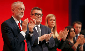 Jeremy Corbyn with Tom Watson, among others, at the Labour party conference in Liverpool [Image: Peter Nicholls/Reuters].