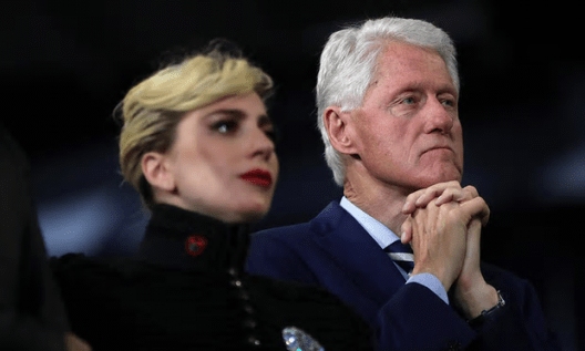 Bill Clinton at a campaign rally at North Carolina State University - with Lady Gaga, whose stage name is highly appropriate to the comments attributed to the ex-president [Image: Justin Sullivan/Getty Images].