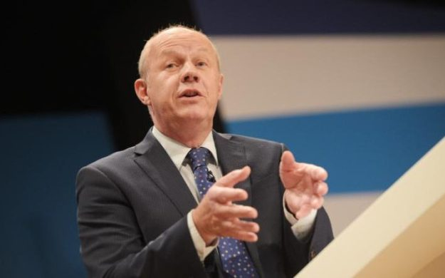 """I'll squeeze them 'til the pips squeak!"" Alternatively, Work and Pensions Secretary Damian Green may be saying something else about benefit claimants [Image: Ben Birchall/PA]."