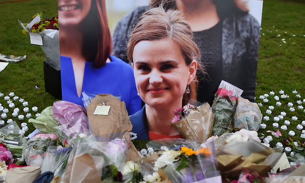 Flowers and tributes placed by a photo of Jo Cox in Parliament Square after she was killed [Image: Ben Stansall/AFP/Getty Images].