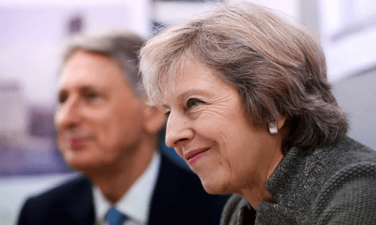 The poll revealed that 44 per cent of the public had faith in Hammond and May to run the economy [Image: Pool/Reuters].