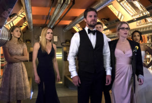 Arrow characters dressed for a wedding. They wear regular clothes more often than superhero costumes