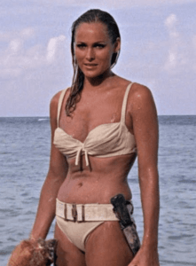 Ursula Andress as a bikini-clad Honey Ryder in Dr. No. The image of Andress emerging from the ocean to greet 007 is one of the most famous examples of Mulvey's male gaze.